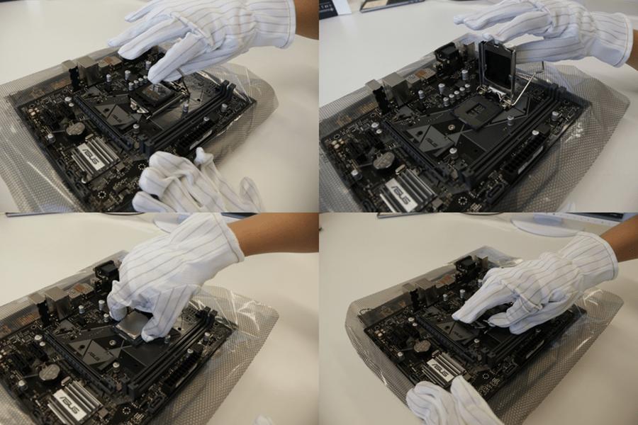 レバーを起こしカバーを開けCPUを置いて金属レバーを戻す